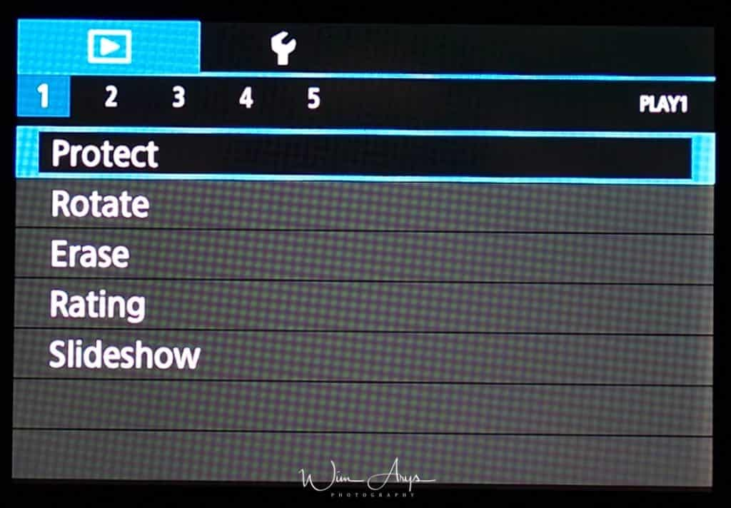 Canon EOS M100 playback menu page 1