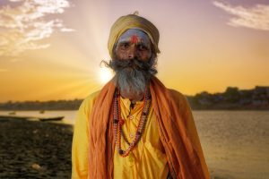 Yellow Sadhu on the Ganges river bank, Varanasi, India