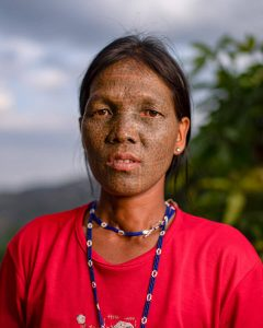 Young Chin tribe woman with face tattoos, Myanmar
