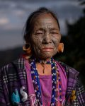 Chin tribe woman 3 with face tattoos, Myanmar