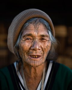 Chin tribe woman with face tattoos, Myanmar